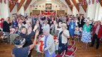 Residents toasting the Queen at Brownsword Hall in Poundbury PHOTO: Neil Crick