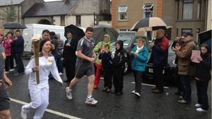 The torch being carried in Aughnacloy