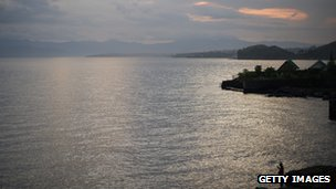 A view over the city of Goma in the eastern province of North Kivu in the Democratic Republic of the Congo as a man fishes on the edge of Lake Kivu on May 28, 2012.