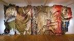 In the World but Don't Know the World by El Anatsui