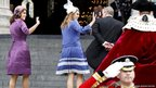Princess Beatrice and Princess Eugenie wave as they arrive with their father Prince Andrew