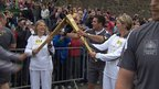 Kathleen Irvine hands the flame over to Lisa Hickson