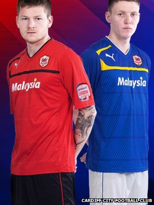 Midfielder Aron Gunnarsson in the new red home shirt and striker Joe Mason in Cardiff's new blue away strip.