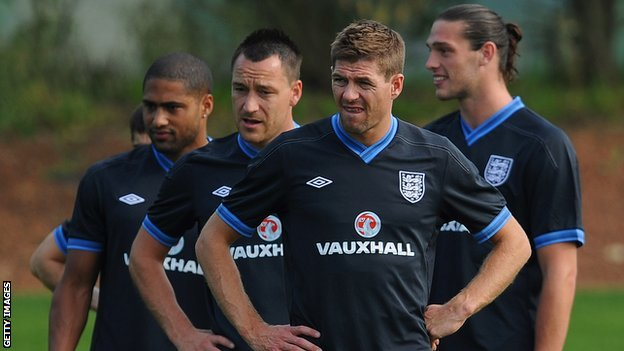 Steven Gerrard looks on in England training