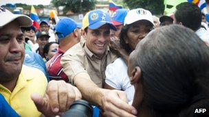 Henrique Capriles (centre) on the campaign trail on 1 June