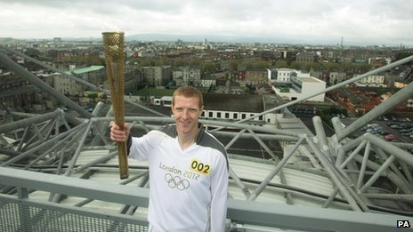 Hurling player Henry Shefflin carried the torch atop Croke Park