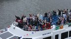 Passengers partying on boat on the river