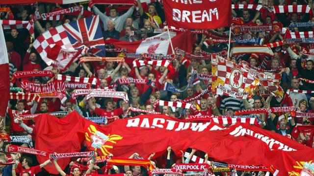 Liverpool supporters at the famous Kop cheer Liverpool
