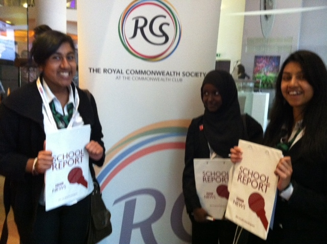 School Reporters in front of RCs logo