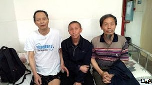 Li Wangyang (L) posing for a photo with his friends in Shaoyang, in central China's Hunan province, June 2012