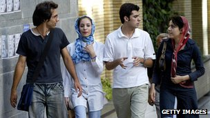 Young Iranian adults walking down a street