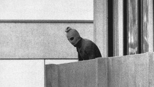 Masked man on balcony in Olympic village in Munich 1972