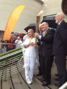 Mayor of Lisburn Alderman William Leathem and torchbearer Evie Dorman with the Olympic flame