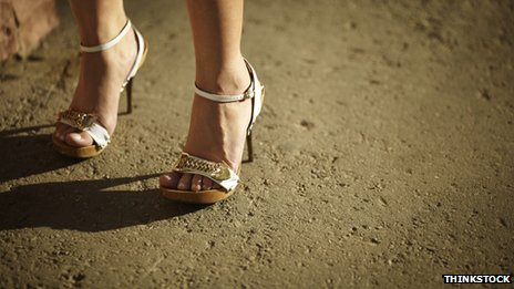 Woman's feet wearing high heels