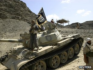 Al-Qaeda-linked militants drive a tank in southern Yemen (28 April 2012)