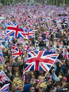 Huge crowds cheering with Britain&quot;s Union flags march down the Mall towards Buckingham Palace to celebrate the Queen&quot;s Diamond Jubilee in London on June 5, 2012.
