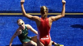 Michellie Jones of Australia looks on as Brigitte McMahon of Switzerland celebrates winning gold