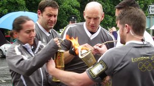 The weather made lighting the torch a more difficult proposition than normal.