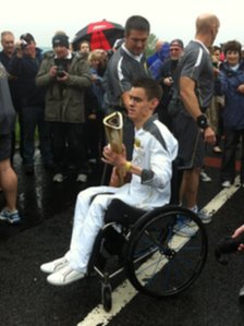 Paul McLister completes his Olympic torch relay stint in Moorfields