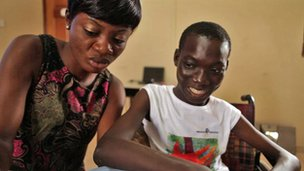 Kofi with teaching assistant Mabel