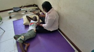 Kofi and his physical therapist, Alberta