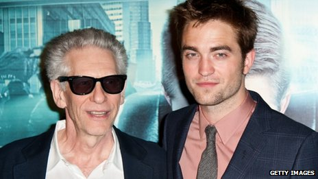 Robert Pattinson (R) and David Cronenberg pose during the Cosmopolis premiere at Le Grand Rex on 30 May in Paris