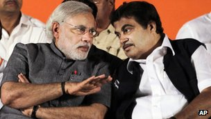 Janata Party (BJP) leader and Chief Minister of Gujarat Narendra Modi, left, speaks with party president Nitin Gadkari during a public rally in Mumbai, India.