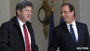 Leader of the Left Front, Jean-Luc Melenchon (left) stands next to French President and Socialist, Francois Hollande