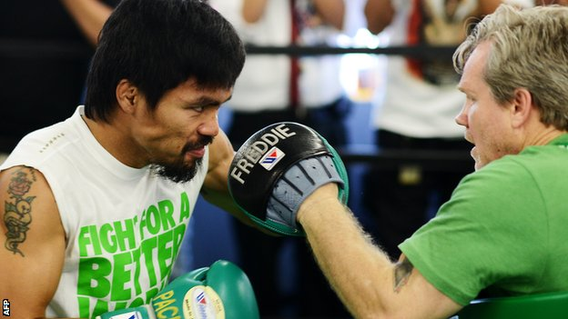 Manny Pacquiao spars with trainer Freddie Roach ahead of his fight with Timothy Bradley