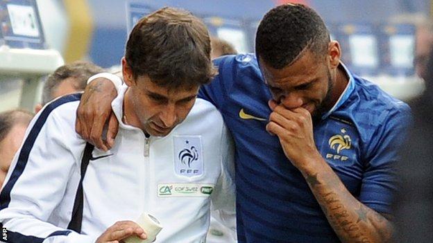 Yann M'Vila hobbles off for France