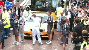 Actor James McAvoy takes his turn with the Olympic torch