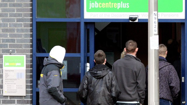 Young people queuing outside a job centre