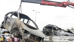 (File photo) A burnt car is removed from the scene of a crash on Lagos Ibadan highway