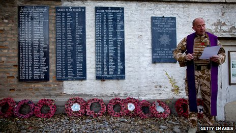 A British military chaplain reads a prayer at a Remembrance Day ceremony at the British Cemetery