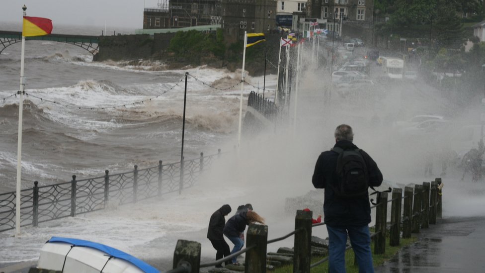 Wave smashes against over a path in Clevedon, North Somerset