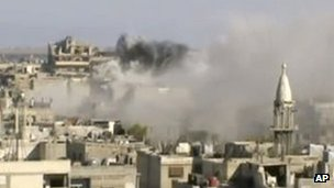Unverified video released on Friday is said to show the city of Homs being shelled