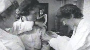 Woman having vaccination
