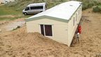 Holiday home buried by sand in Perranporth, Cornwall