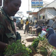 A soldier buys Khat