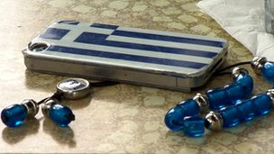 iPhone in a Greek flag case