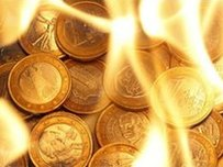 Euro coins in flames