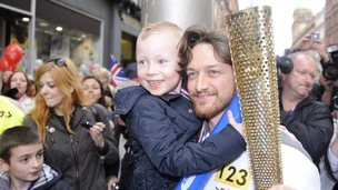 Actor James McAvoy with the Olympic torch in Glasgow