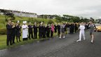 Staff at the Turnberry Golf Resort turnout in force to see Toni McIntosh from Prestwick carry the Olympic torch.