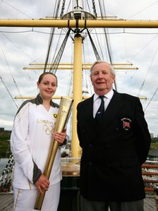 Torchbearer Emma Baird with Olympian Hamish Hardie