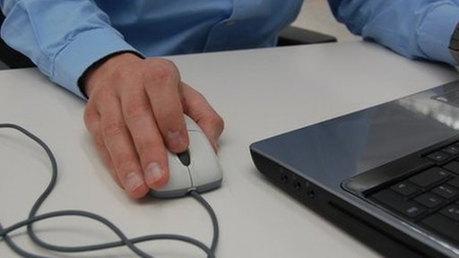 Man using a laptop mouse