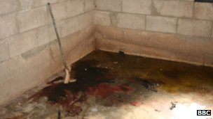 Blood on the floor of a house in Qubair