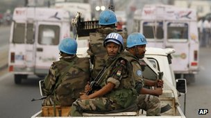 UN soldiers from Niger conduct a patrol through the streets of Abidjan on 10 January 2011.