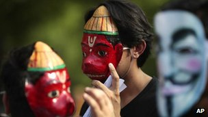 Members of a hacking group, Anonymous India, wear masks of Hanuman, Indian monkey headed god, along with masks of Guy Fawkes