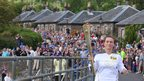 Ruth Leith with the Olympic flame in Luss
