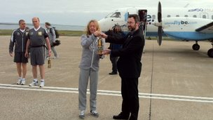 London 2012 Olympic flame arrives at Kirkwall airport